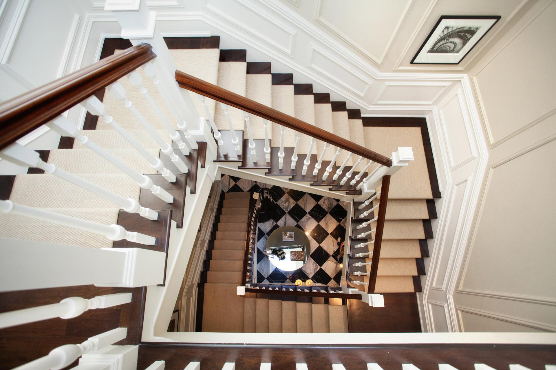 Custom millwork staircase stairs wainscotting