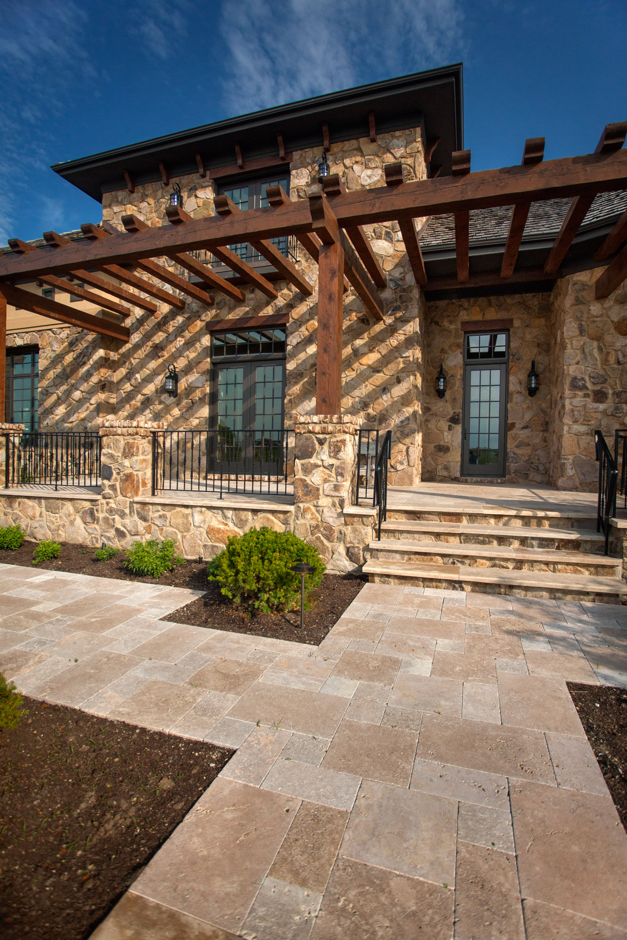Spanish southwestern marble travertine exterior entry