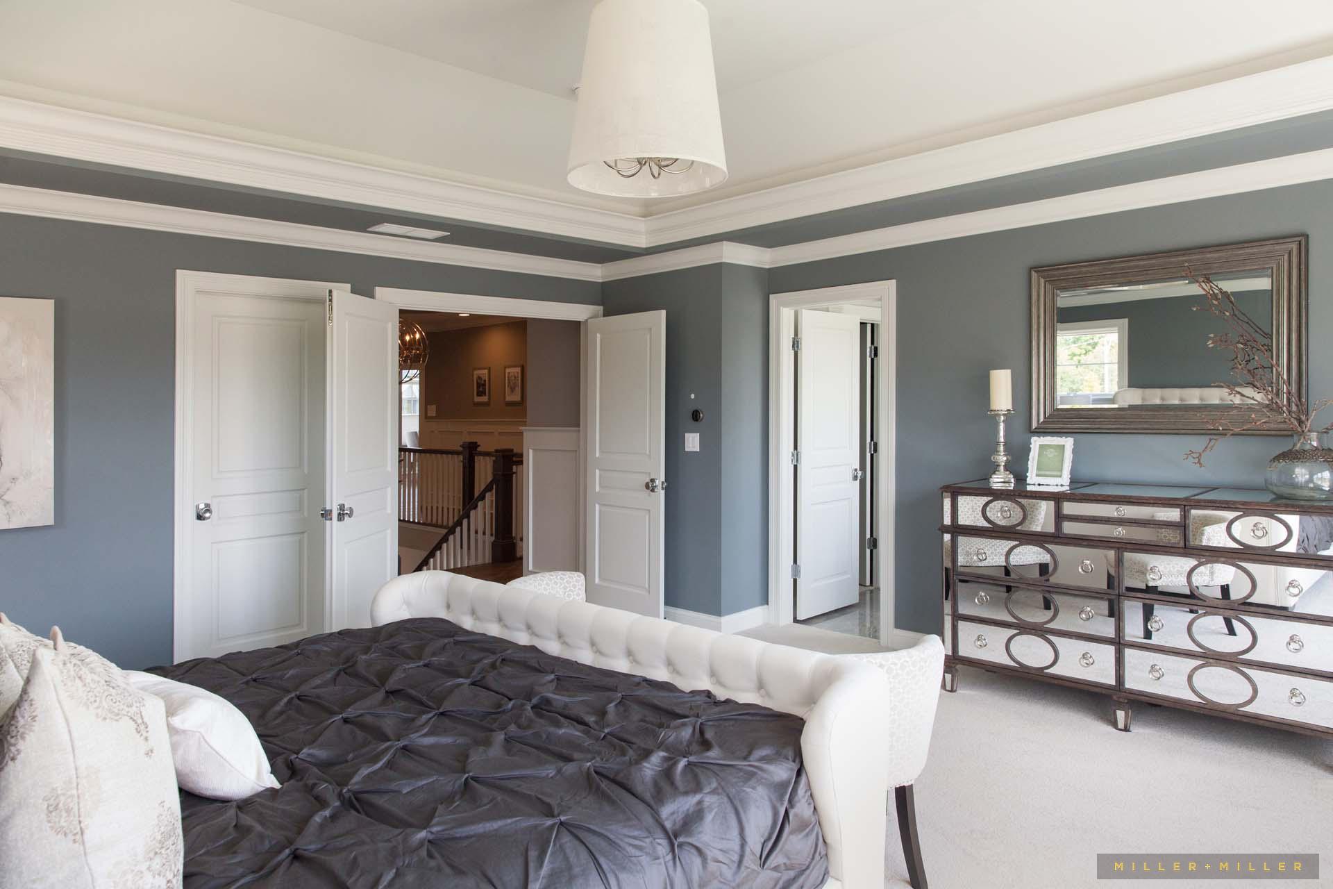 upholstered-bed-mirrored-dresser-linen-light