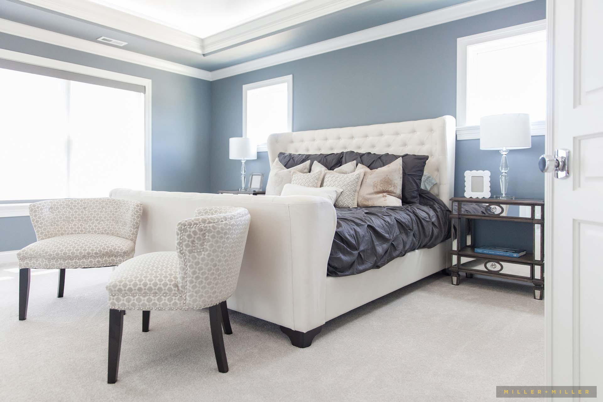 wingback-button-tufted-headboard-master-bed-blue-walls